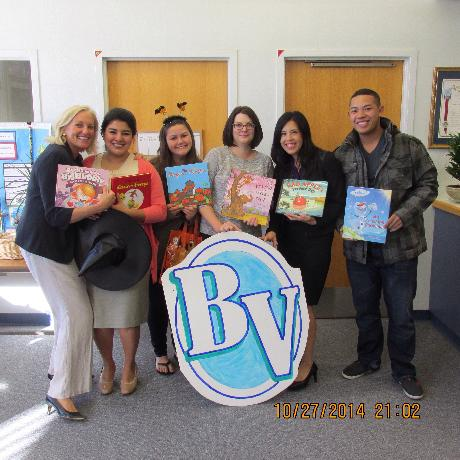 Volunteers from the Aviara Four Seasons Residence Club read to BV students in  celebration of National Reading Month.